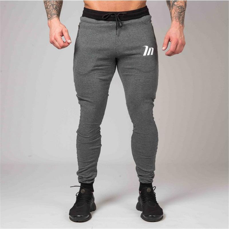 2018 New Tight Men Pants Zipper Packet Bodyboulding Gyms Brand Clothing  Cotton Trousers Fitness Jogger Sweatpants High Quality UK 2019 From  Benedica 1fef1ea07c4e
