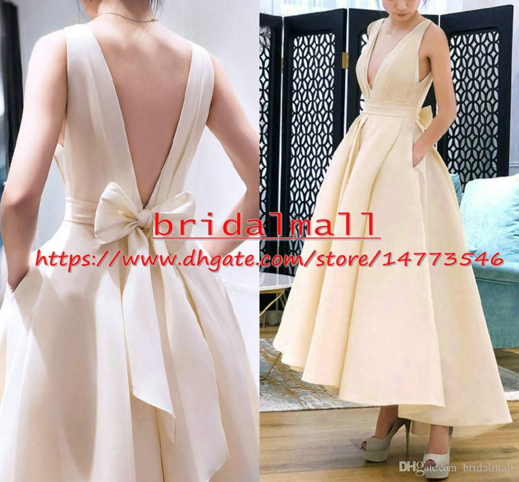 96358289b1 Discount Bowknot 2019 Beige Satin Hi Lo Wedding Dresses With Pockets ...