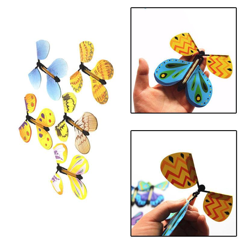 1 Stück kreative lustige Trans Fliegen-Schmetterlings-Kokon in einem Schmetterlinge Trick Prop magischer Spielwaren-Partei Urlaub Kinder DIY Spielzeug