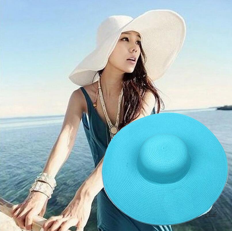 e2fffaad 2019 Lady Sun Straw Beach Hat Cap Women Large Floppy Folding Wide Brim Cap  Beach Panama Church Grass Braid Hats AAA2001 From Nb_sport, $4.5 |  DHgate.Com