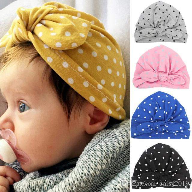 c8c41aed37646 2019 Sweet Dot Baby Girls Hat Newborn Infant Bowknot Candy Color Turban Cap  Soft Elastic Infant Accessories Kids Beanie From Daisy2019