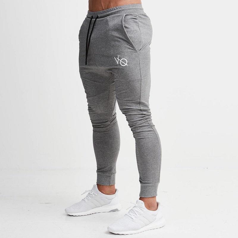 Compre Pantalones De Chándal Grises Pantalones De Rayas Para Correr Hombres  Lápiz Deportivo Hombres Algodón Suave Culturismo Joggers Gimnasio Pantalones  ... 3c9ab0fd4144