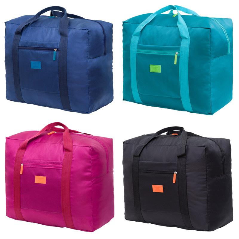 b77d347cc IUX New Fashion Travel Pouch Waterproof Unisex Travel Handbags Women ...
