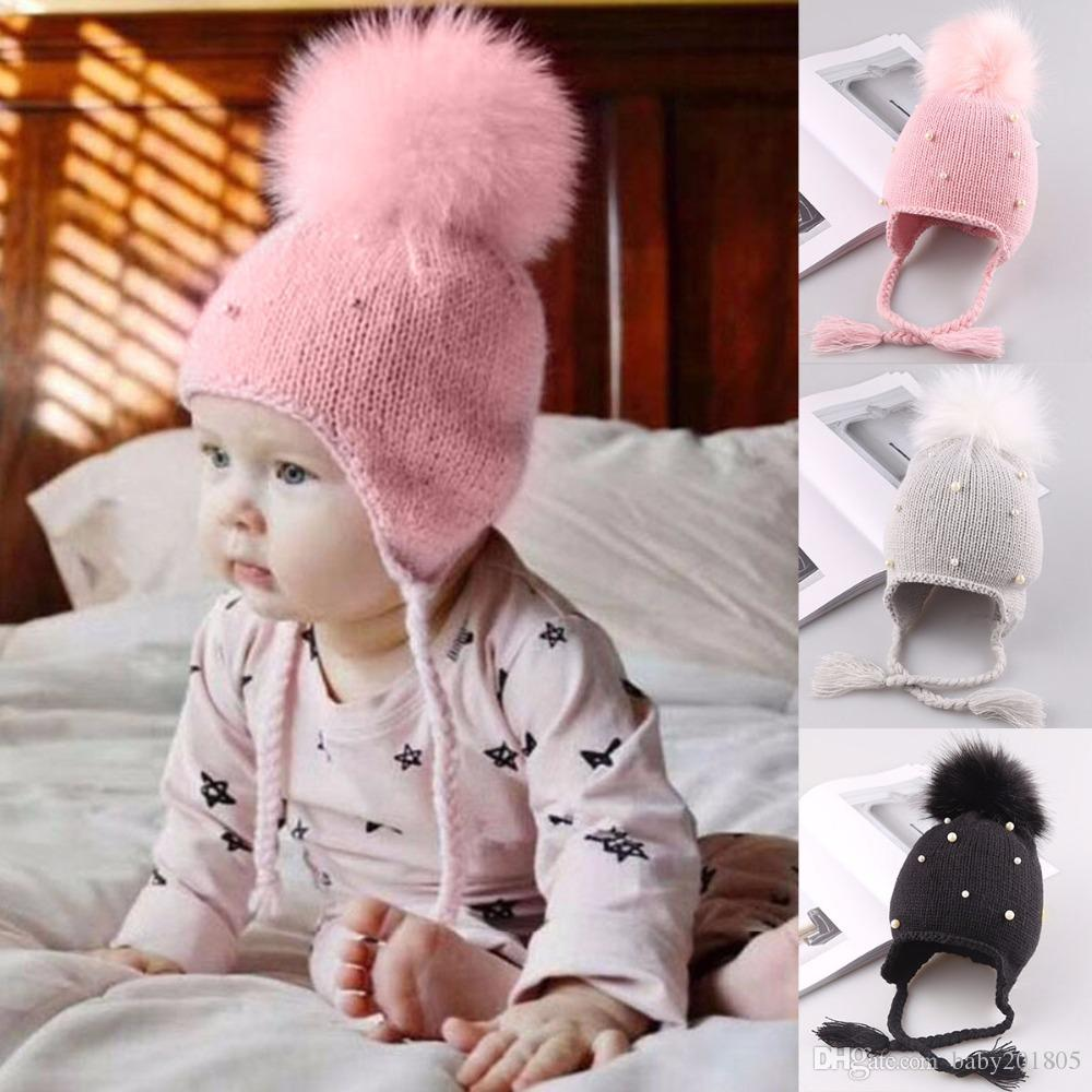 76f95f9b4c7 2019 Puseky Baby Winter Hat Fur Pompom Caps Bonnet Enfant Toddler Boys  Girls Knitted Cap Cotton Protect Ears Hats Warm Kids Beanie From  Baby201805