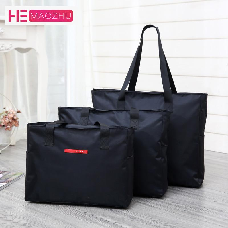 The New Oxford Cloth Black Travel Bag Carrying Luggage Bag Men S Duffle  Lady Travel Handbag Big Weekend Package Overnight Wheeled Backpacks Travel  Bags For ... f96e9846a317e