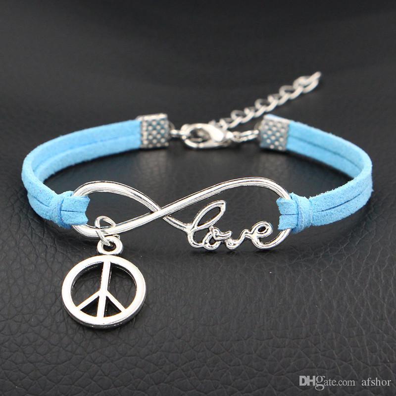 4062e68ff6bf Compre Caliente Simple Azul Cuerda De Cuero Ajustable Color Plata Infinito  Amor Paz Ronda Signo Pulsera Para Mujeres Hombres Niñas Brazaletes De  Regalo ...