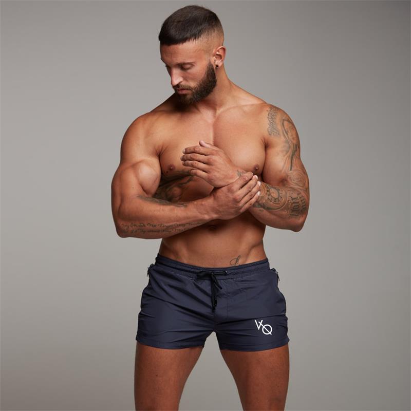 017355f52 Compre 2018 Nuevos Hombres Traje De Baño Sexy Traje De Baño Hombres  Pantalones Cortos De Natación Hombres Calzoncillos Pantalones Cortos De  Playa Trajes ...