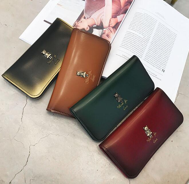 2019 Free shipping Factory direct selling women retro color leather long wallet large capacity mobile phone bag fashionable metal handheld
