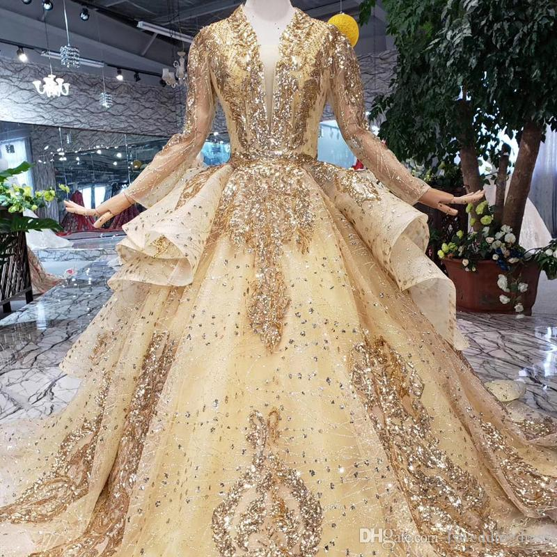 b4de1971998 2019 Newest Gold Muslim Evening Dresses Ruffles Beaded Luxury Applique  Evening Gowns Long Tulle Sleeve Sexy Deep V Neck Prom Gowns Lebanon  Celebrity Prom ...