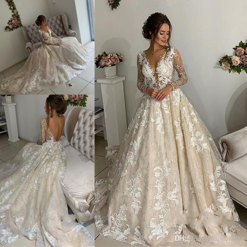 Discount 2019 Romantic A Line Long Sleeves Wedding Dresses Deep V Neck Lace  Appliques Open Back Court Train Plus Size Bridal Gowns Plus Size Bridal  Bridal ... 3323e498b744