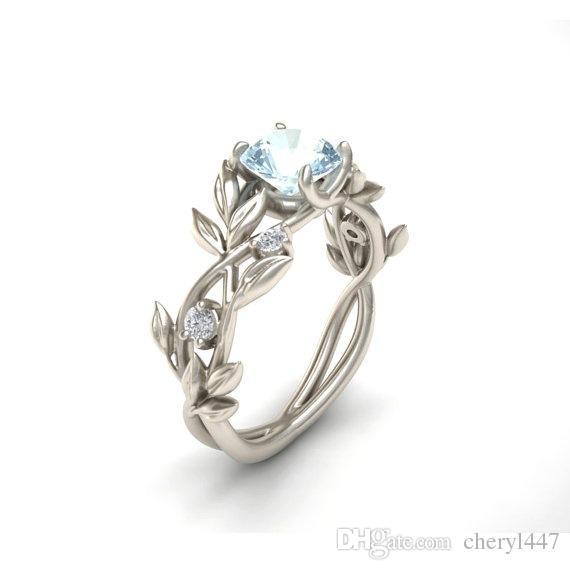 a2e766a5d109 Compre 2019 Anillos De Compromiso De La Hoja De Olivo De La Princesa  Europea Y Americana Y Americana Con Anillo De Diamante Azul Diamante A   13.19 Del ...