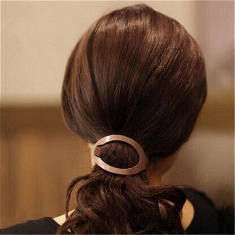 Livraison gratuite 1 pc Femmes Filles En Plastique Souple Cheveux Clip Bun Maker Barrette Styling Outil Nouveau Mode Accessoires De Cheveux Noir / Brun