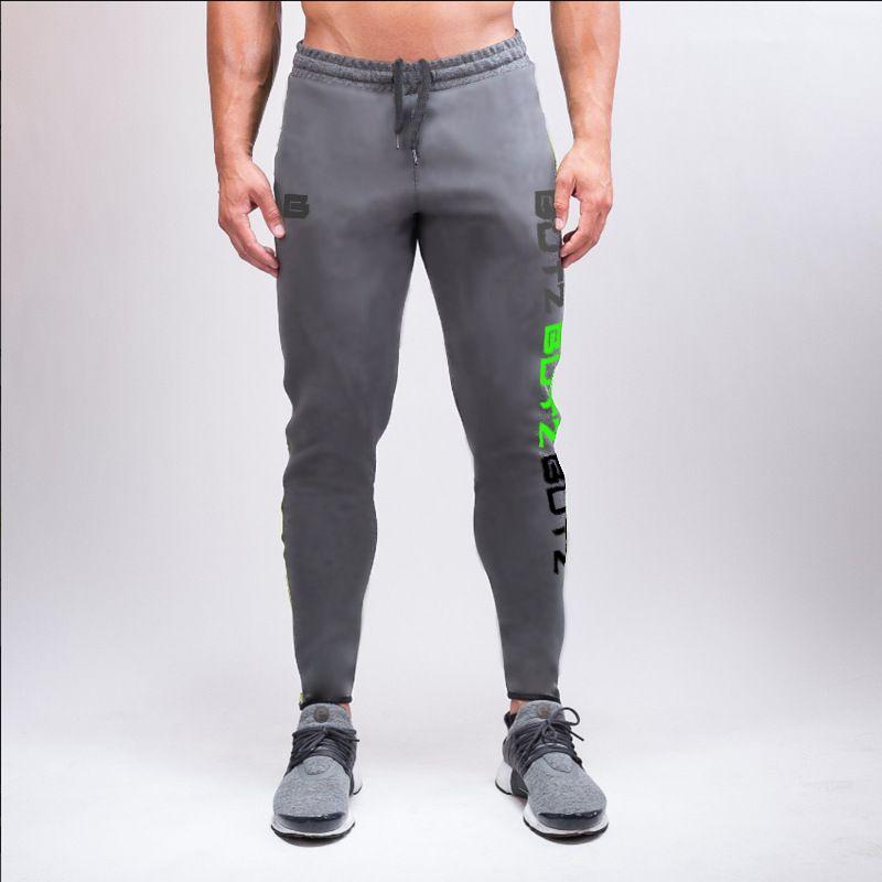 Compre Pantalones De Chándal Grises Pantalones Para Correr Hombres Lápiz  Deportivo Hombres Algodón Suave Culturismo Joggers Gimnasio Pantalones  Mallas Para ... 29f1b93fb4a8
