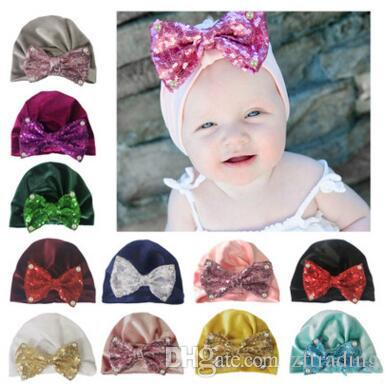 17a1b77cd08 2019 Sequin Bow Pearl Nylon Hat Winter Warm Crimping Newborn Boys Girls Caps  Wool Hats From Zftrading