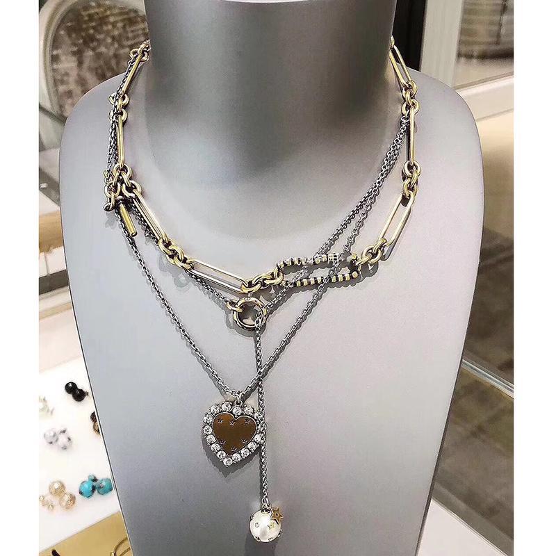 3c1d1f6d5440 Compre Marca De Joyería De Moda Para Las Mujeres Corazón Choker Cadena  Vintage Colgantes De Estrellas Collar De Cristal Partido Muchas Cadenas De  Moda 36cm ...