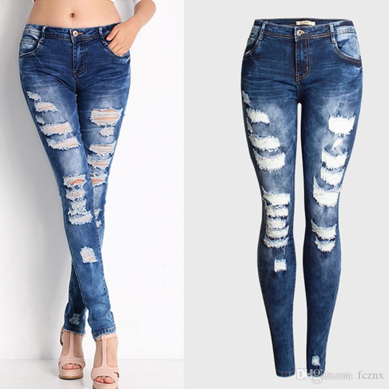 eef704afb42 Compre 2019 Ropa De Mujer Cintura Baja Apretado Elástico Sólido Pantalones  Vaqueros De Algodón Mujer Casual Moda Agujero Flaco Lápiz De Mezclilla  Pantalones ...