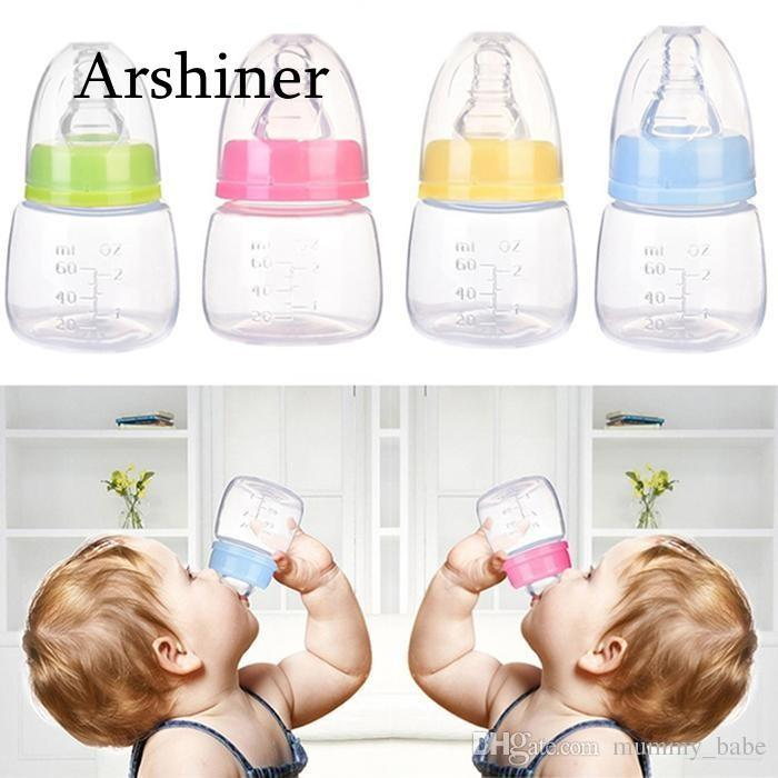 fd6fbe8e2 2019 60ml Newborn Baby Infant Nursing Milk Fruit Juice Water Feeding  Standard Mouth Silicone Nipple Pacifier Drink Bottle From Mummy babe