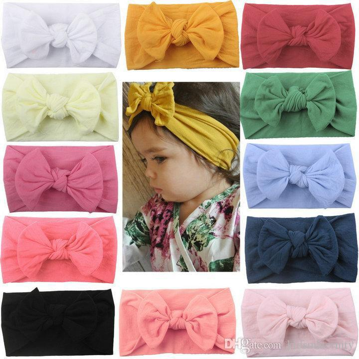 2019 New INS European American Baby Candy Colori solidi Morbidi Nylon Bow Fasce Baby Girl Neonati Eleganti Archi per capelli Accessori
