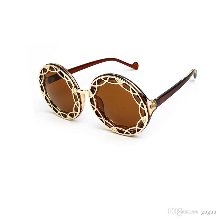 142a9dbcd Compre Mulheres De Metal Oco Fora Círculo Óculos De Sol Das Senhoras Da  Europa Net Moda Americana Rodada Óculos De Armação De Leopardo Óculos De  Praia Do ...