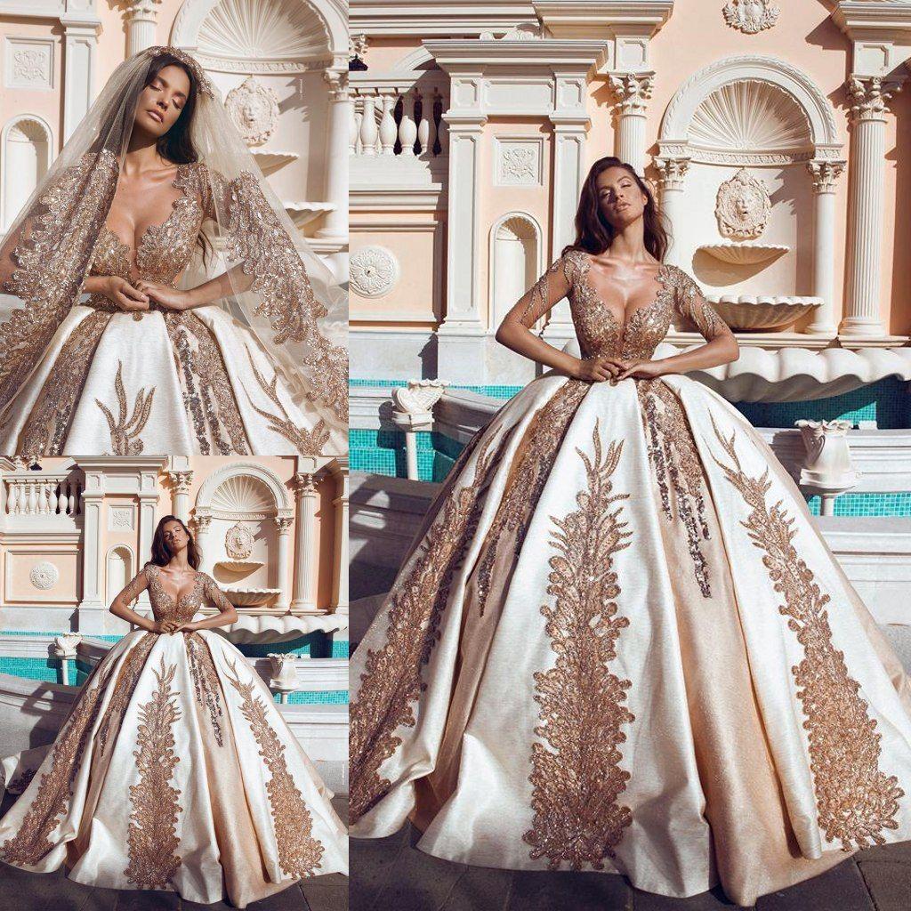 fd1901be45 Saudi Arabia Shiny Gold Wedding Dresses Lace Sequins Long Sleeve Ball Gown  Dubai Bridal Gowns Chapel Plus Size robe de mariée