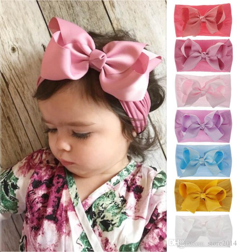 2019 0 7 Years Baby Ribbon Bows Nylon Headbands Toddler Girls Soft Elastic  Nylon Head Bands Candy Colors Knot Bow Turban Head Wraps Hair Bands From ... a36dc92da22