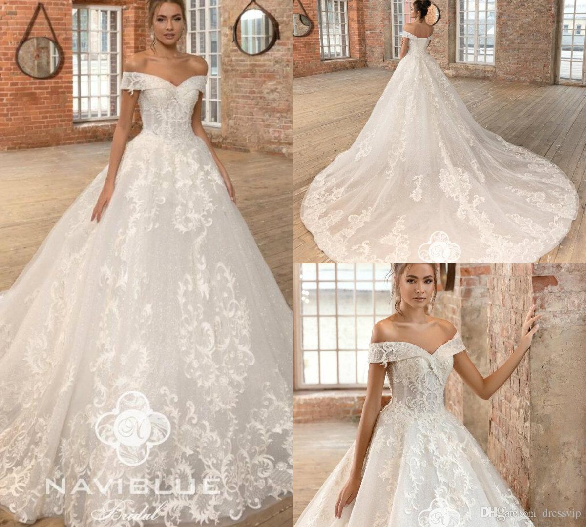 ccaa541407d Discount 2019 Naviblue Dolly Beach Wedding Dresses Off The Shoulder Lace  Appliqued A Line Glitter Modest Wedding Dress Court Train Bridal Gowns  Wedding ...