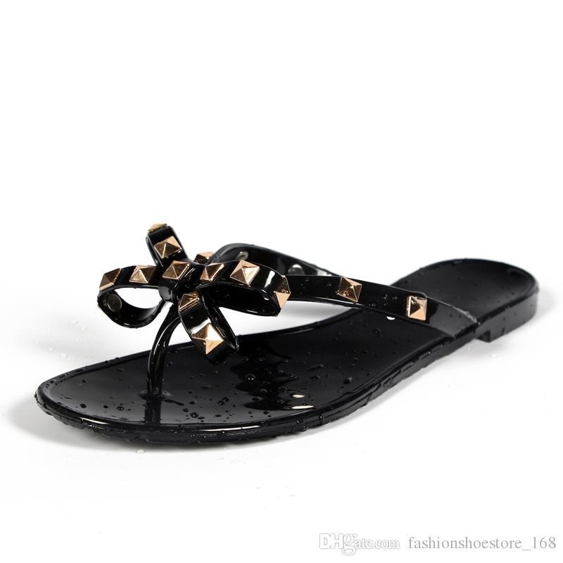 3a2a85b0cb646 2019 European Summer New Fashion Rivet Slippers Bow Flat Flip Flops ...