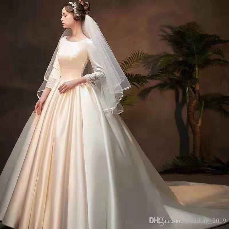 A-Line Wedding DressesHot-selling Ivory Satin small round-necked long-sleeved skirt with pleated Lace Applique tail strap customized package