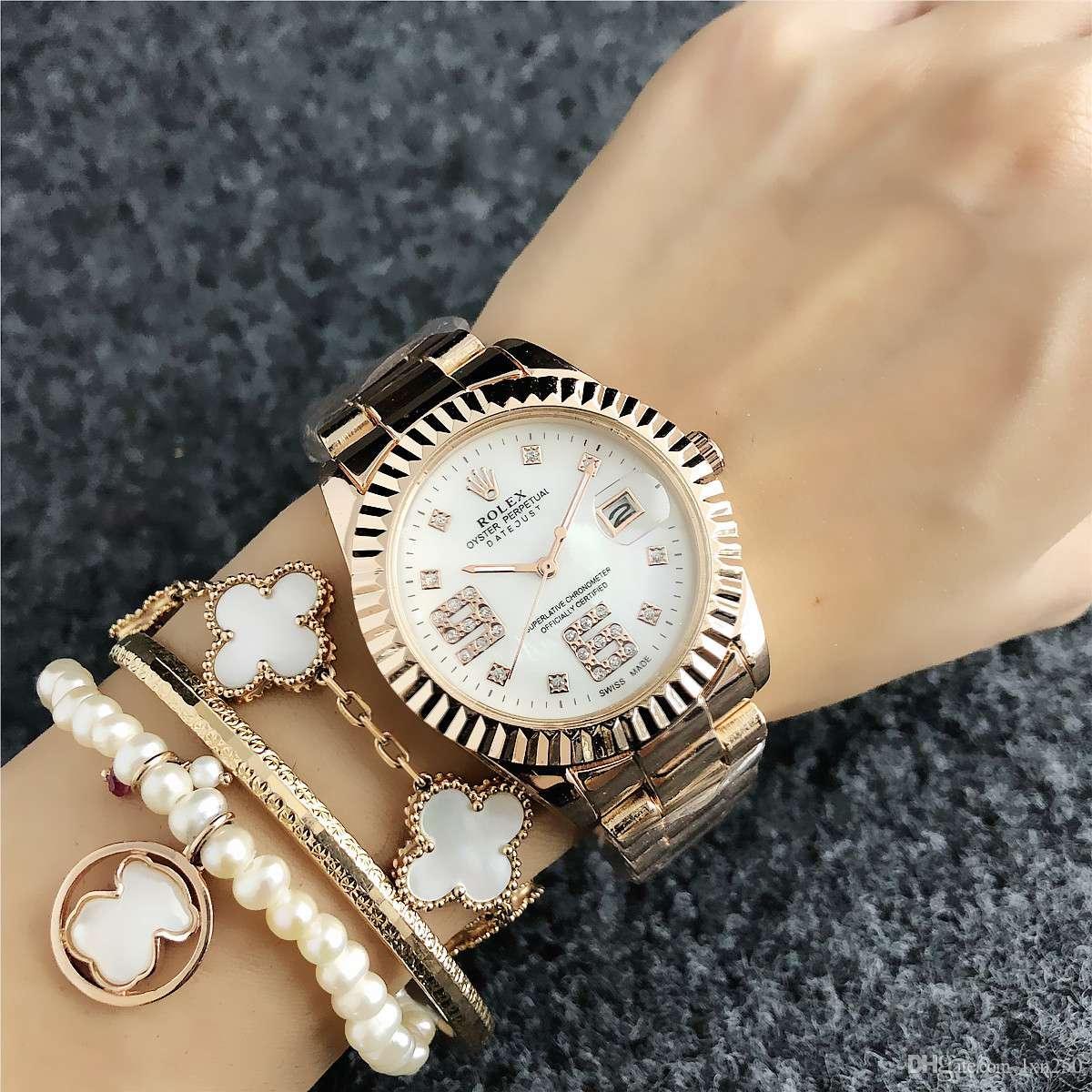 b2a266bce7a Compre Moda Marca De Relógio De Prata Pulseira De Cristal Senhoras Assistem  Vestido De Ouro Rosa De Aço Inoxidável Com Calendário Relógio Relogio  Feminino ...