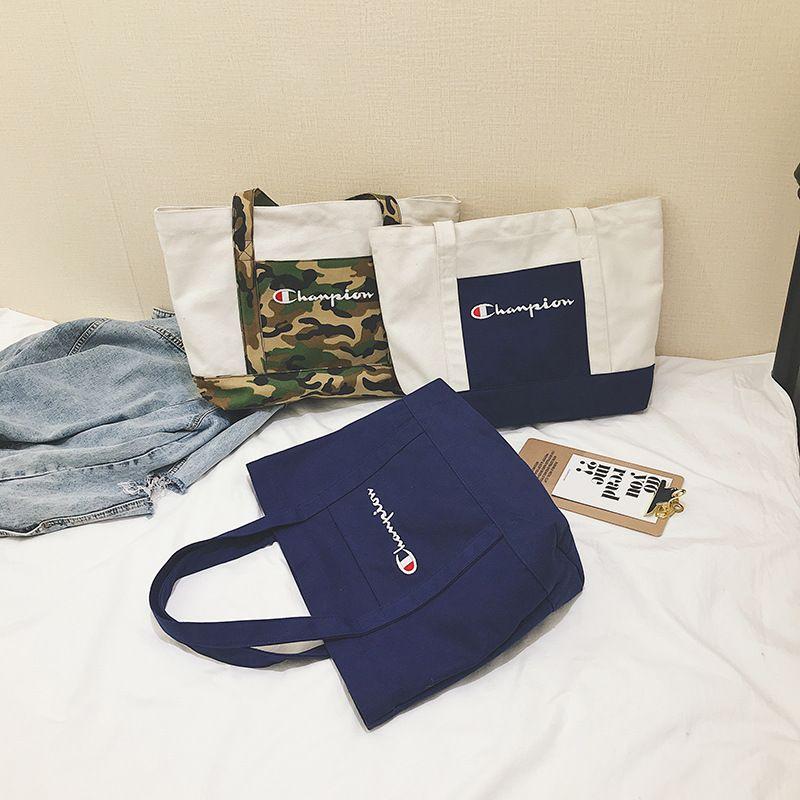 3d6b8c793509 Women Champions Canvas Handbag Camo Patchwork Totes Letter Printed Shoulder  Bag Large Capacity Handbag Casual Travel Shopping Bags New C424