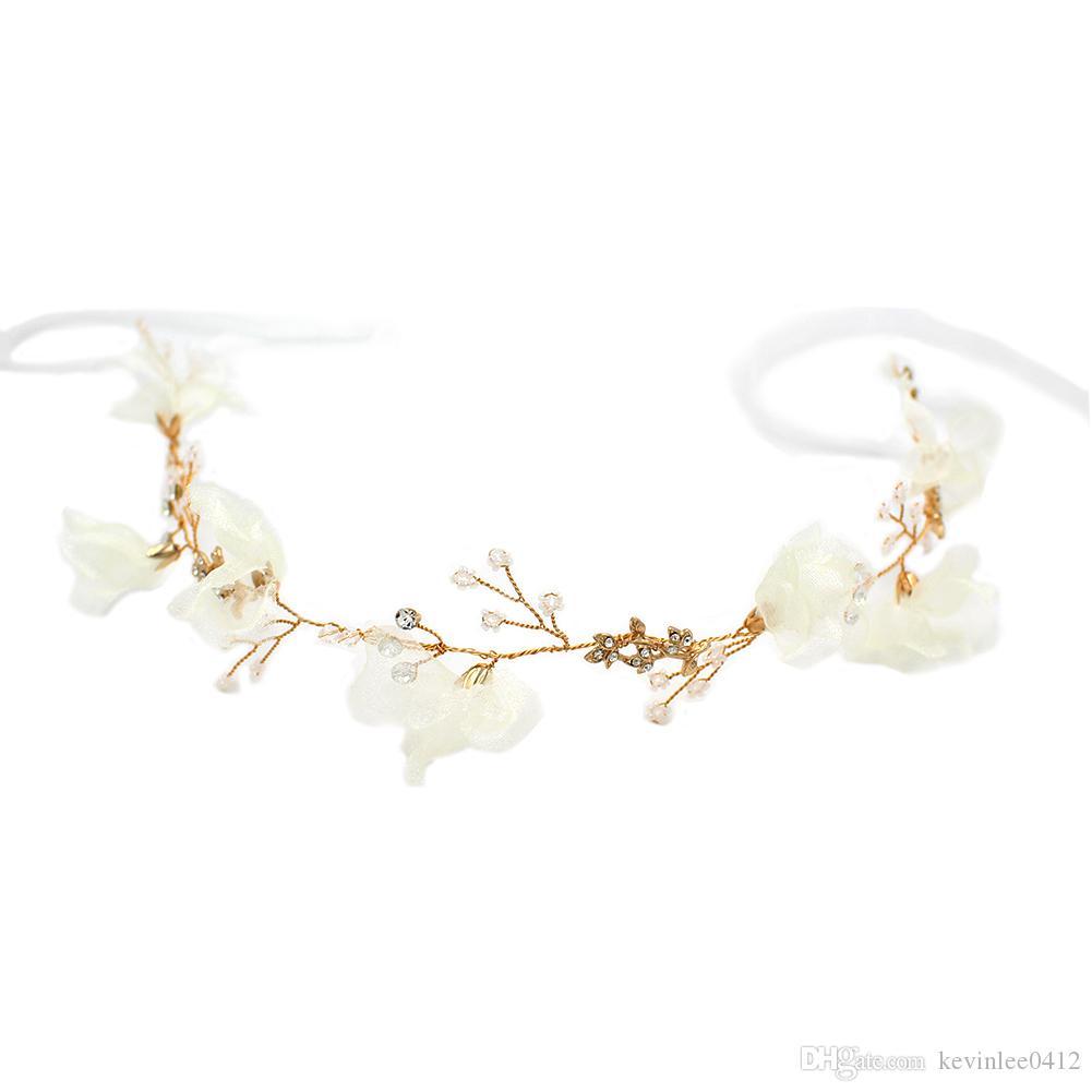https://www.dhresource.com/0x0s/f2-albu-g10-M01-48-28-rBVaVl0EYfOAQjC2AAKbZOVy0OM355.jpg/cute-alloy-headbands-earrings-with-flower-and-rhinestone-two-pieces-pearls-flower-wedding-bridal-jewelry-set-dress-hair-accessories.jpg
