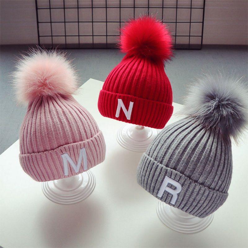 2019 Winter Women Men Kids Warm Beanie Faux Fur Pompom Caps Knitted Boy  Girl Hats Scarf From Jumeiluo 18564e103b