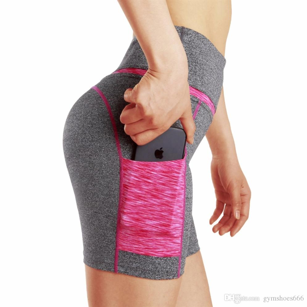 7a1b7d0ed4d87 2019 High Waist Side Pocket Yoga Shorts Tummy Control Workout Running  Sports 4 Way Stretch Color Block Tight Shorts For Women #74872 From  Gymshoes666, ...