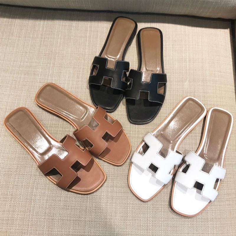 Compre Tian Verão Preto Ou Branco H Senhoras Sandálias De Grife Senhoras  Sandálias De Luxo Real Sapatos De Couro Sapatos Baixos Chinelos Moda  Feminina De ... 05d23d01fca