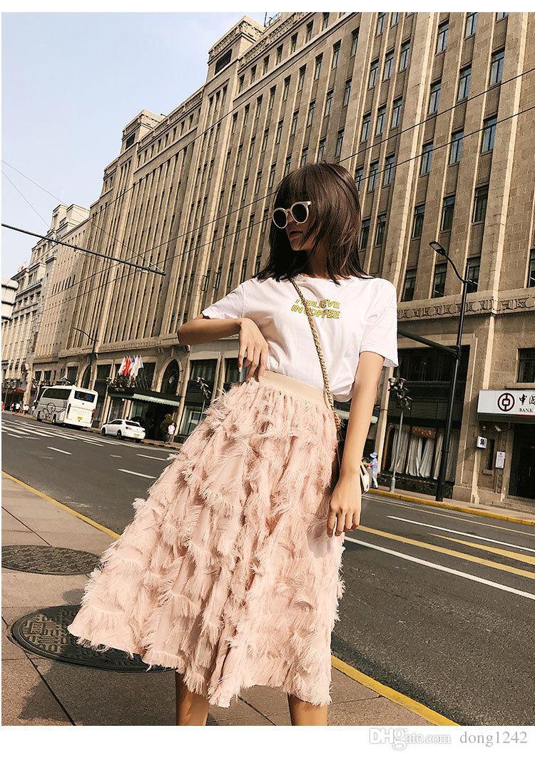 f94e09c01 Falda de cintura alta con borla de plumas en la falda larga falda plisada  de invierno