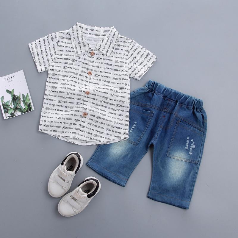 c52bfc3797fd 2019 2019 Boy New Summer Kids Set Baby Boy Clothes Lapel English Alphabet  Shirt Top + Shorts Sets Children Clothes From Xiaocao01