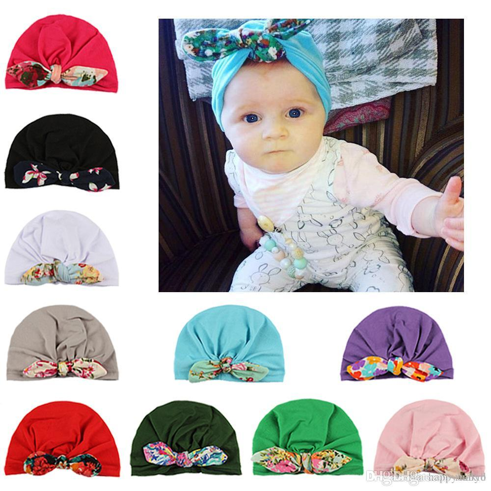 9d951d7a6 2019 2018 New Europe US Baby Hats Bunny Ear Caps Flower Turban Knot Head  Wraps Infant Kids India Hats Ears Cover From Runkid