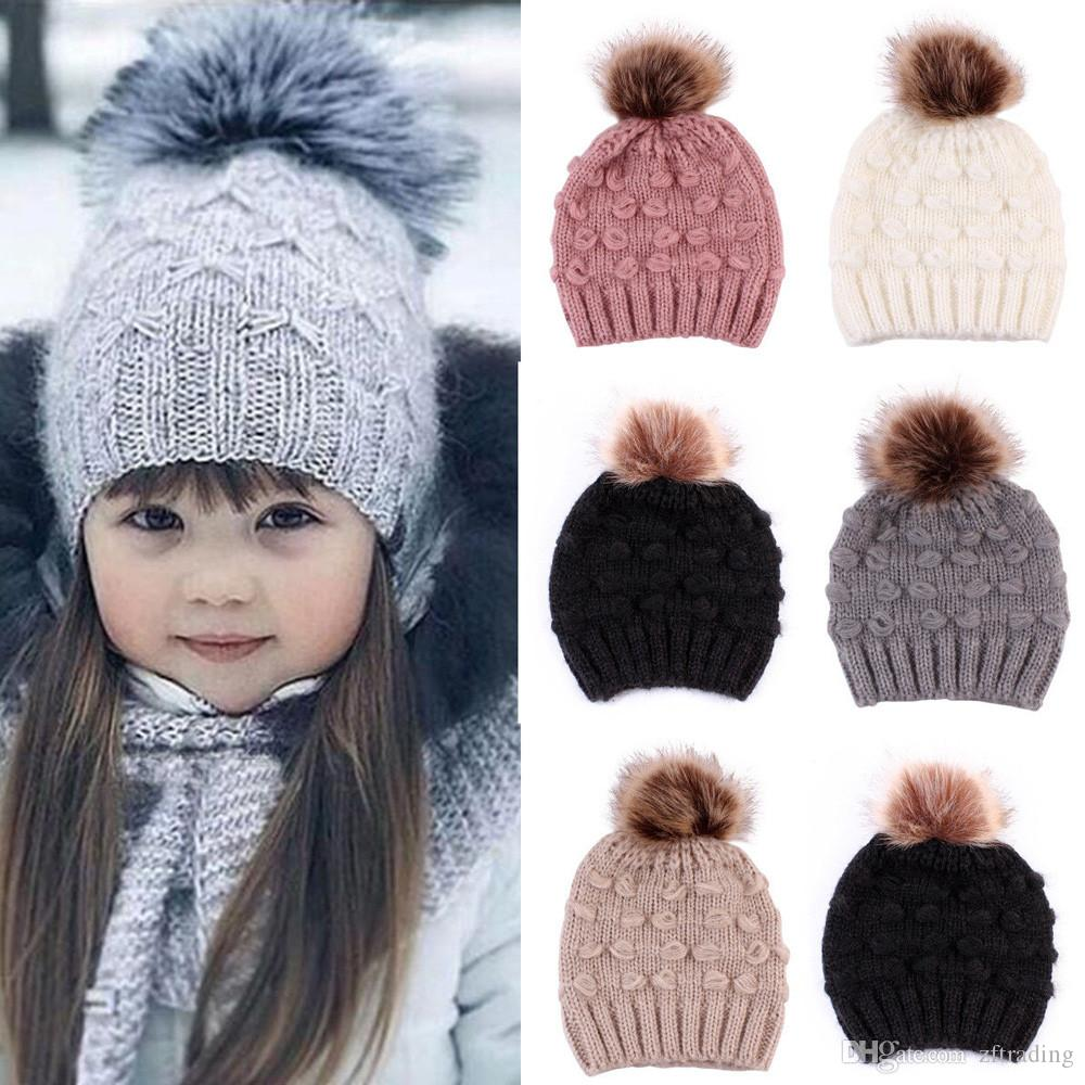 e672c507681 2019 Kids Winter Knitted Hat Pompom Ball Warmer Wool Fur Hats Baby Boys  Girls Knitted Caps Beanies From Zftrading