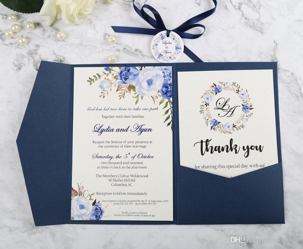 new arrival blue trifold pocket wedding invitation with rsvp card and ribbon and round tag