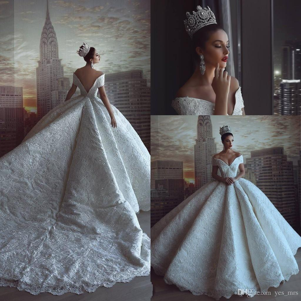 2019 Sexy Luxury Arabic Ball Gown Wedding Dresses Off Shoulder Full Lace  Crystal Beaded Open Back Chapel Train Puffy Plus Size Bridal Gowns Celtic  Wedding ... f7500a8b4846
