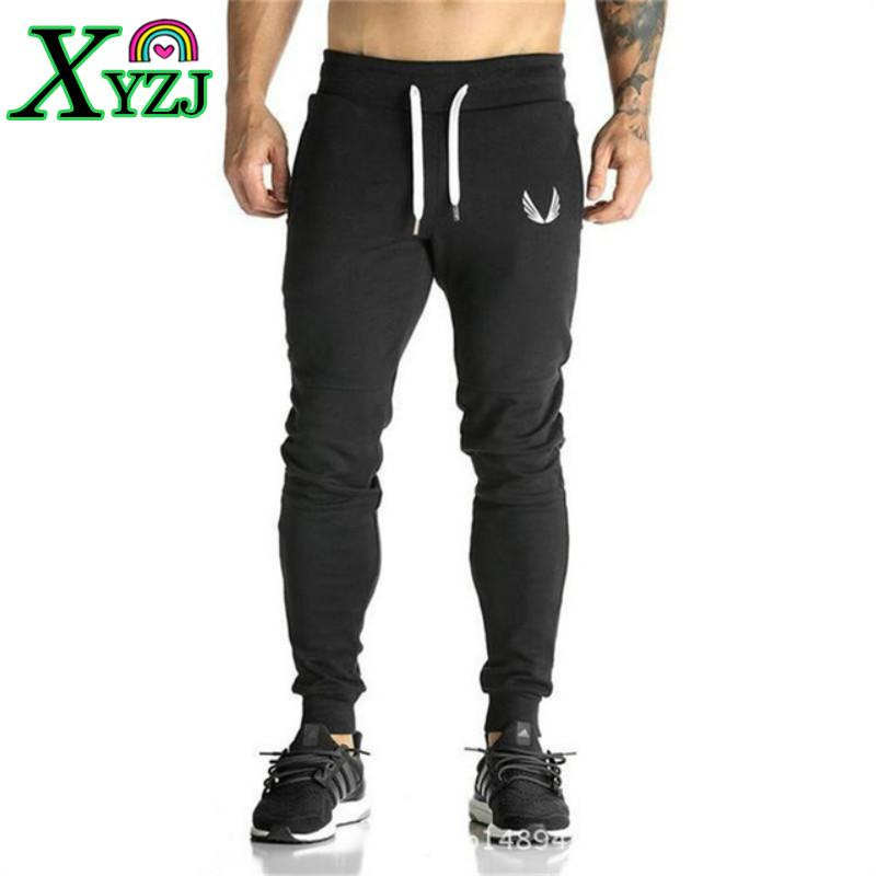 97a80cd3e075 2019 Joggers Jogging Pants Men Fitness Workout Pants Skinny Sweatpants Gym  Training Running Sport Pants Men Tights Trousers From Xyzj