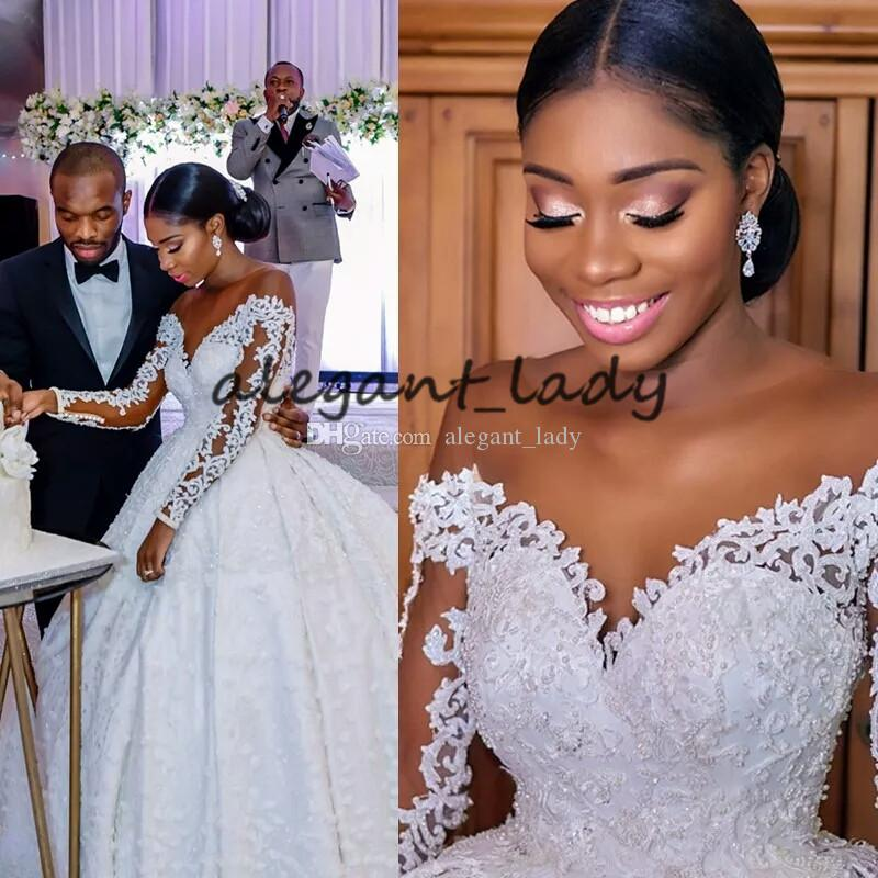 Plus Size Long Sleeve Wedding Dresses with Illusion Jewel Neck 2019 Luxury Lace Embroidery butterfly African Nigerian Princess Wedding Gown