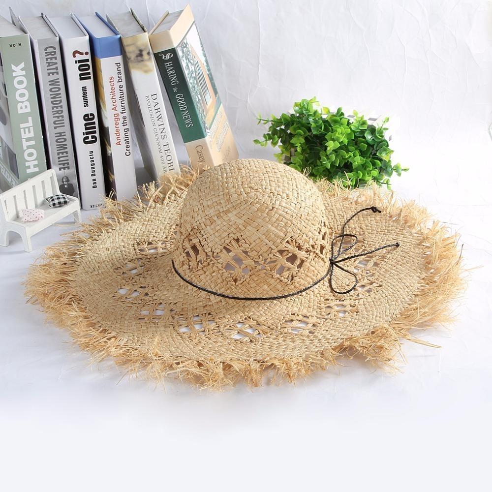 Compre Gran Ancho De Ala Sombreros De Paja Sólido Bowknots Sombrero De Playa  Señoras De Moda Sombrero De Sol Gorras De Verano Fluff Floppy Sol Caps ... a39ec890bae