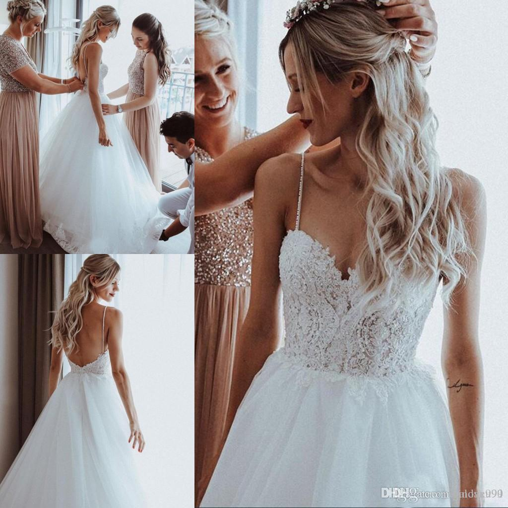 Discount 2019 Beaded Pearls Tulle A Line Boho Wedding Dresses Sweep Train  Spaghetti Straps Beach Bridal Gowns 2018 Appliques Wedding Gowns For Brides  ... 84a15a2ce40b