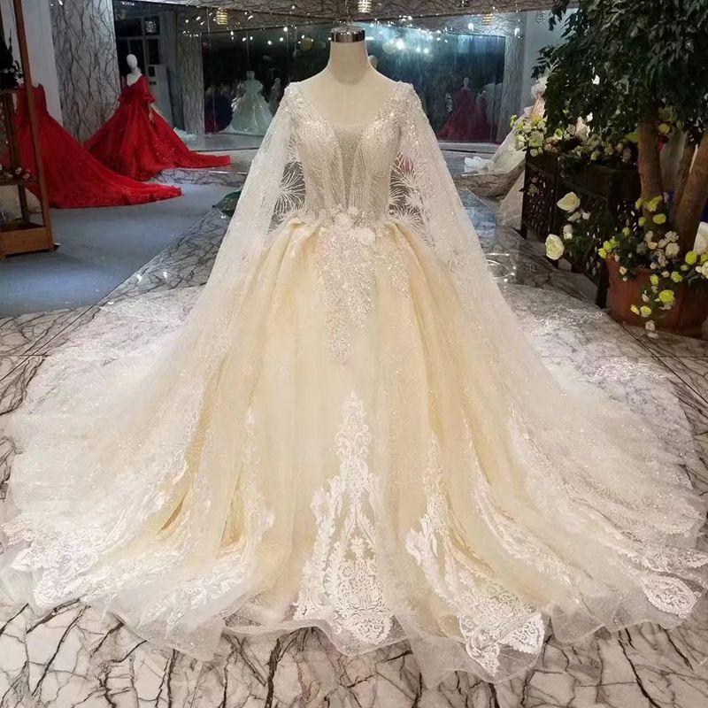 58d335f9fc4 2019 Long Tulle Cape Wedding Dresses Luxury Light Champagne Illusion V Neck  Detail Applique Deep V Back Wedding Gown With Long Train Croatia Purple  Dresses ...