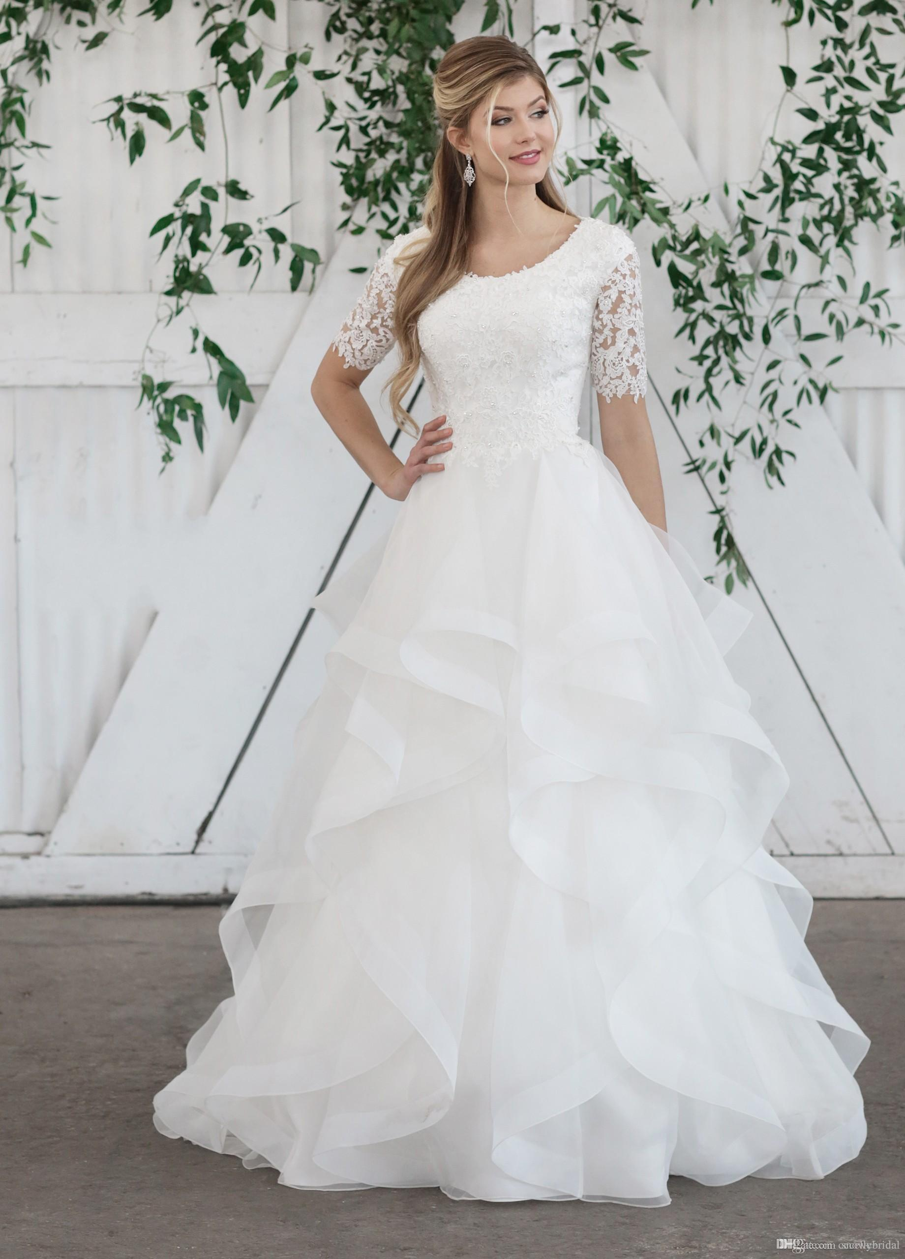 Modest Wedding Dress.2019 New Ball Gown Modest Wedding Dress With Half Sleeves Beaded Lace Top Ruffles Skirt Temple Bridal Gowns Sleeved Custom Made