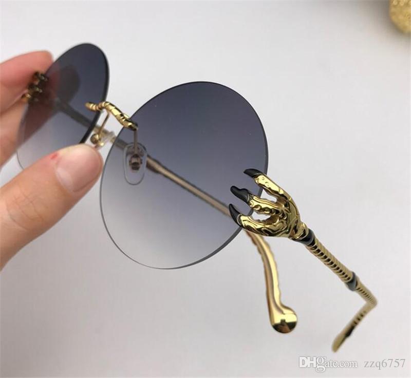 bbc6dc75b9 Compre Nuevo Diseñador De Moda Gafas De Sol 1070 Estilo Sin Marco Redondo  Estilo Popular Lentes De Color De Verano Protección Uv400 Gafas  Ornamentales A ...
