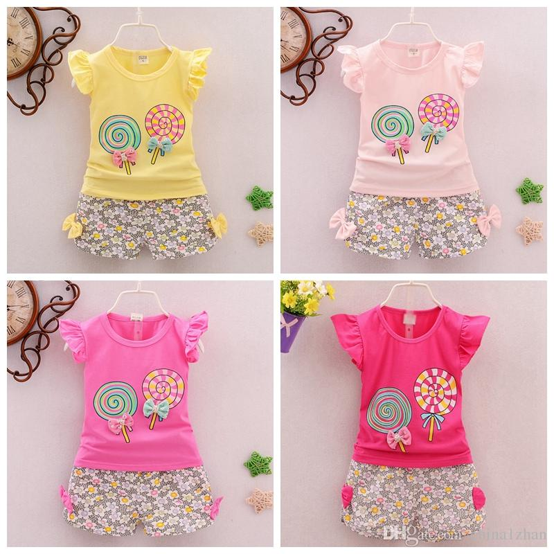 3c5dd0525dc77 Baby Girls Outfits Lollipop Printed Kids Tops Floral Shorts 2pcs Sets Sweet  Girls Clothes Set Fashion Kids Clothing 7 Colors DHW2448