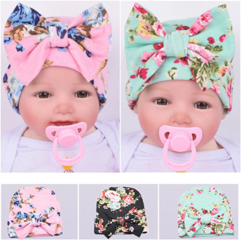 71688d1ae93 2019 Beanie Hats Cute Newborn Baby Infant Girl Toddler Floral Print Comfy  Bowknot Girls Cotton Hospital Cap From Vingner