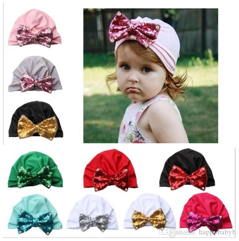 e2b8f27461128 2019 Baby Hats Big Sequin Bow Caps Kids Children Headwear Turban Knot  Elastic Caps Head Wraps India Bow Hats Hair Accessories From Happybabyb